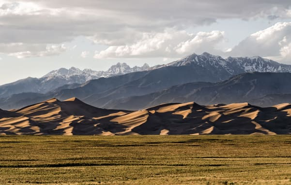 The rolling, warm sands of Great Sand Dunes National Park are a must-stop on your Colorado family road trip.
