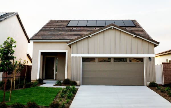 Solar panels on roof of house to help create a more eco-friendly home