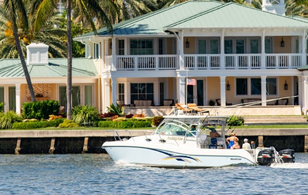 People on a boat tour by mansions in Fort Lauderdale, Florida