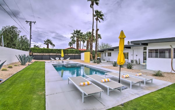 Pool and backyard at a Palm Springs vacation rental home