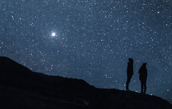 Two people stargazing in Colorado's Black Canyon of the Gunnison National Park