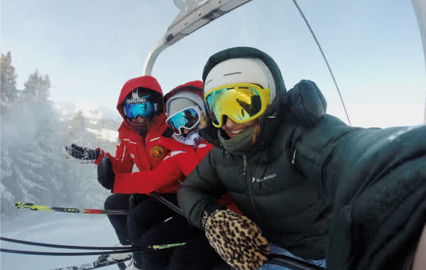 Skiers on lift in winter apparel