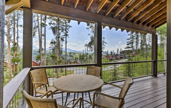 Patio with brown round table and chairs in a Winter Park, CO vacation home