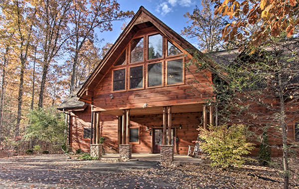 Wood cabin with large windows facing the forest in Gatlinburg, TN
