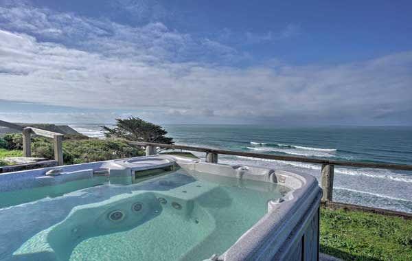Outdoor hot tub on patio overlooking the ocean