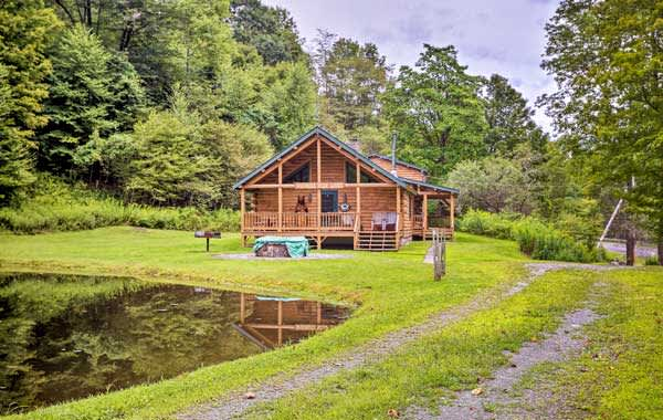 A private, rustic Evolve vacation rental cabin on a small pond