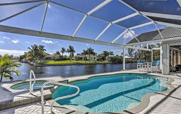 Evolve vacation rental with outdoor pool and hot tub overlooking the canal