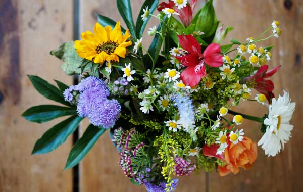 Leave a bouquet of flowers to welcome airbnb vacation rental guests.