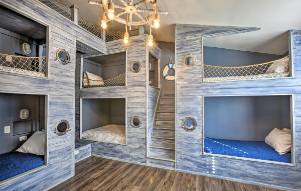 Nautical-themed bunk beds in a luxury family vacation rental in Maple City, Michigan