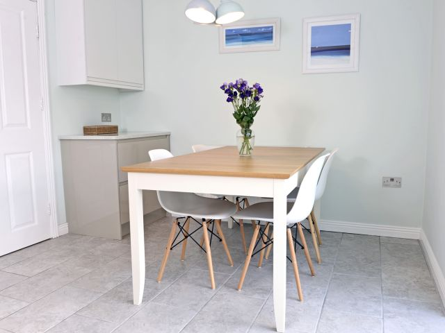 Dining table extends to seat six in this holiday home