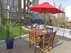Private patio of this central holiday flat thumbnail
