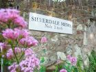 holiday homes eastbourne Silverdale Mews sign thumbnail