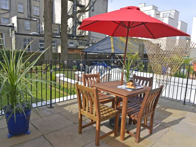 Private patio of this central holiday flat