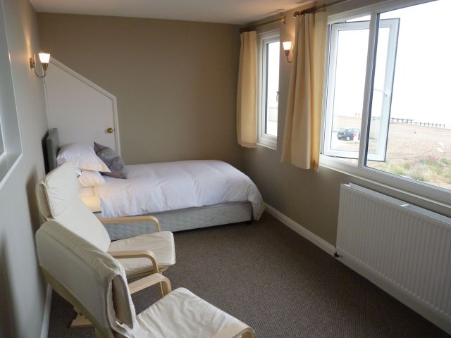 Twin room adjoining beach views