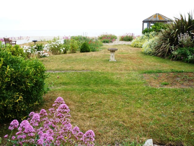 Lovely garden leading on to beach
