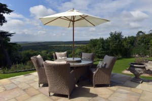 Outdoor dining areas of this countryside lodge
