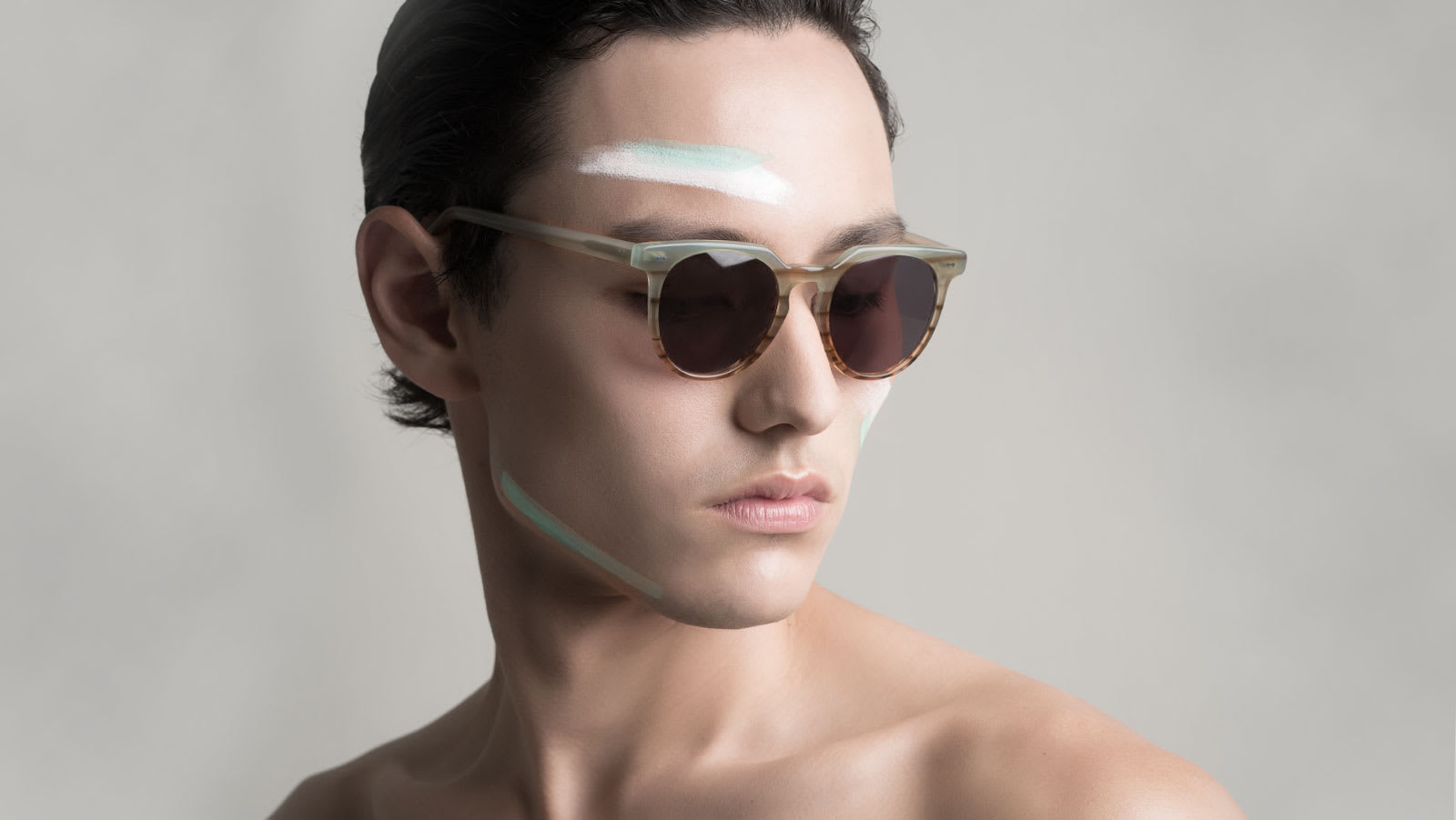 paint on model wearing clear eyeglasses