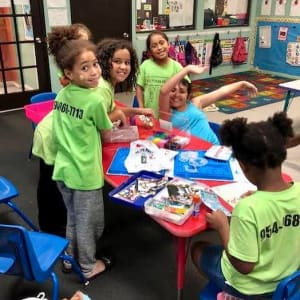 children playing at a table at the toddler club