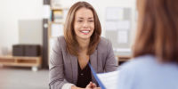 Woman in performance review
