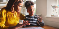 Mom and daughter doing schoolwork