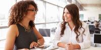 women talking at work