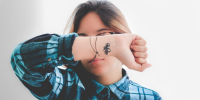 woman with tattoo on her wrist