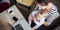 Mom does work with child on lap