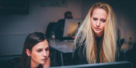 Mentor and mentee at a computer