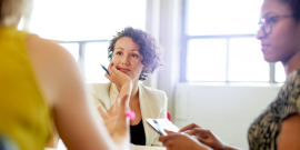 woman at work talking to another person