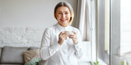 older woman smiling at work