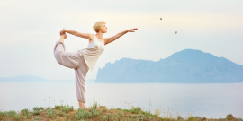 Woman Alone on Vacation, Doing Yoga