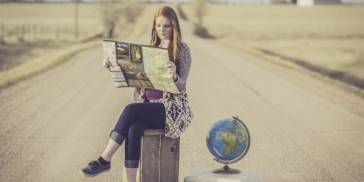 woman reading with globe