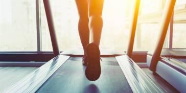 woman walking on a treadmill desk