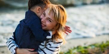 Woman holding boy