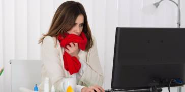 Sick woman at desk