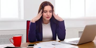 Anxious woman at work