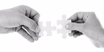 man and woman holding puzzle piece