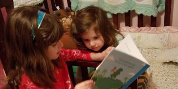 Two children reading a story