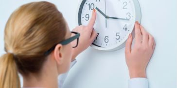 Woman fiddling with clock