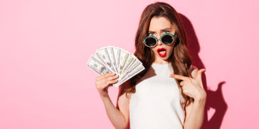 Millennial woman holding money