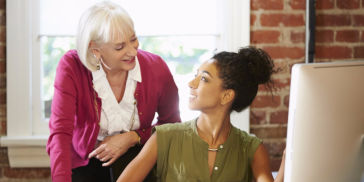 Woman mentoring another woman