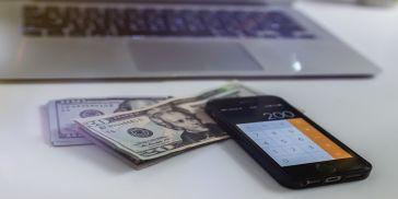 Calculator and dollar bills