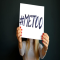 woman holding a #MeToo sign