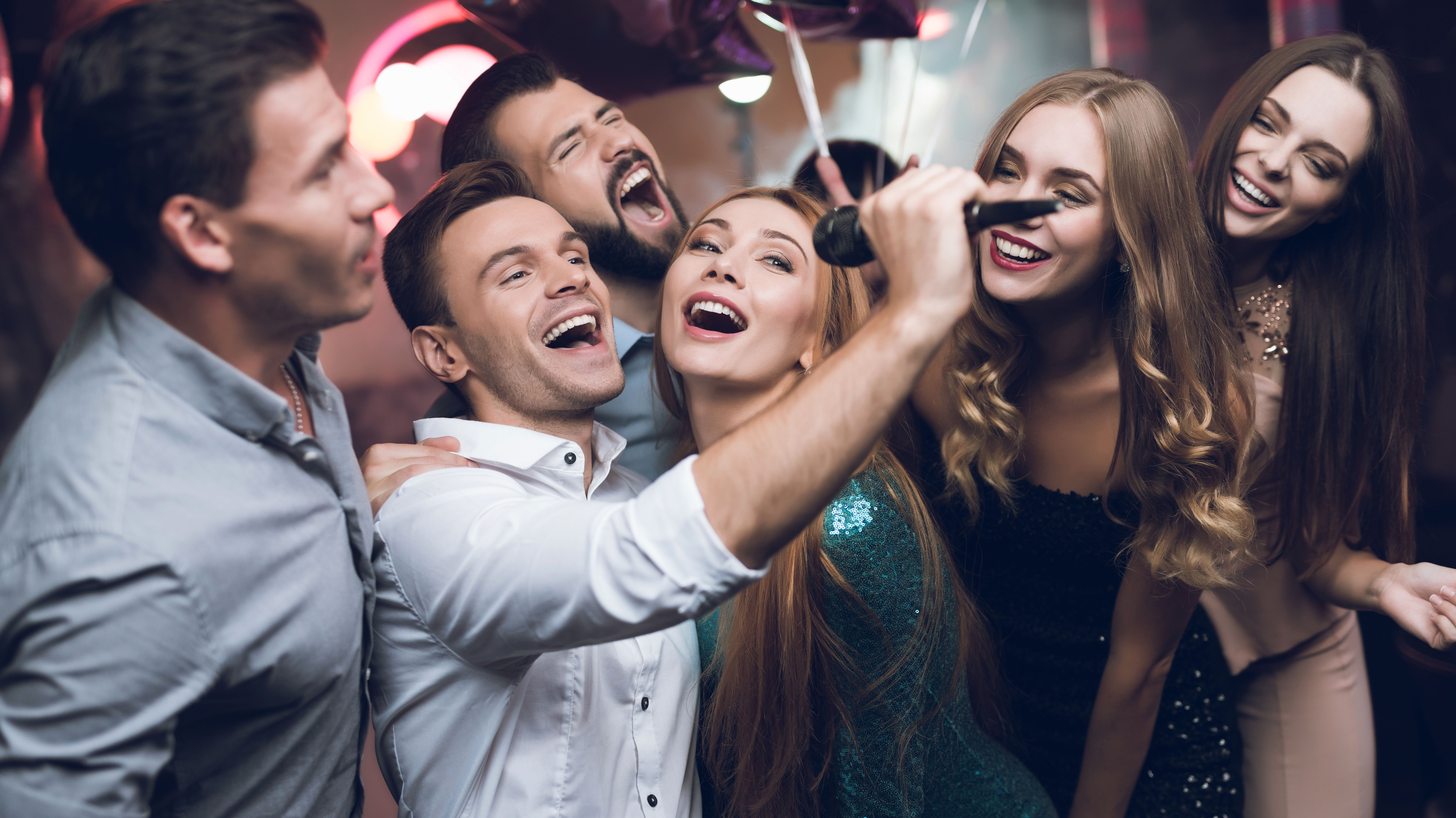 30 Solidly Good Karaoke Songs for Your Next Work Party | Fairygodboss