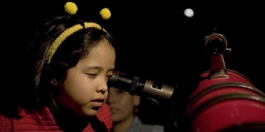 Girl looking in telescope