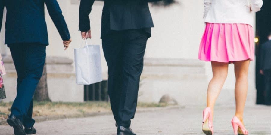 Woman and men walking