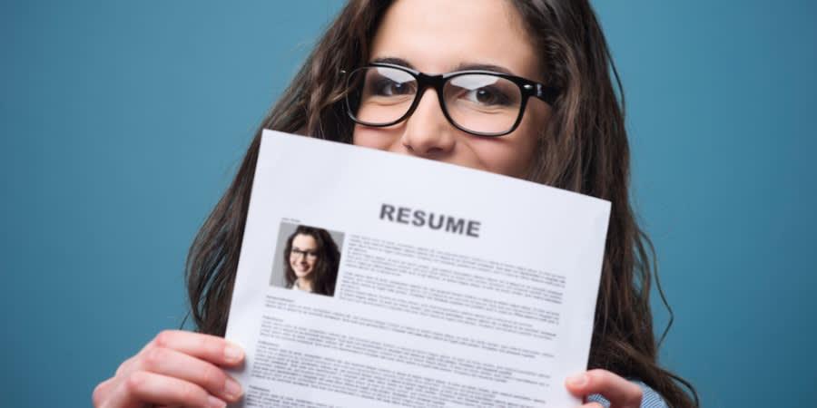 woman holding resume - Resume Tips