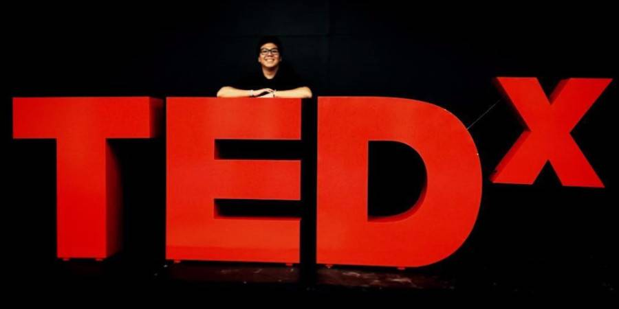 Woman at TED symbol