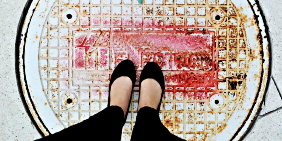 Woman's feet contemplating career break next steps