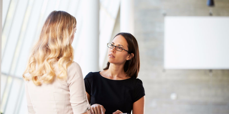 Two women talking in office
